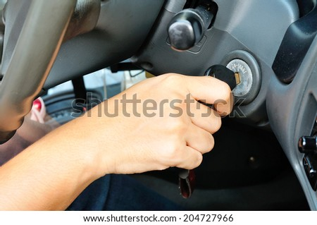 Hand holding car key for starting the car for use as Illustration - stock photo