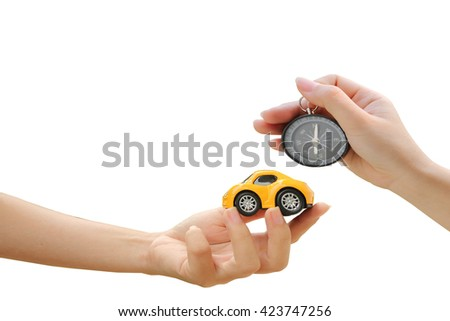 hand holding car model and compass ,isolate white background