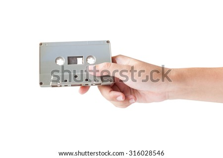 Hand holding cassette tape isolated on white background.