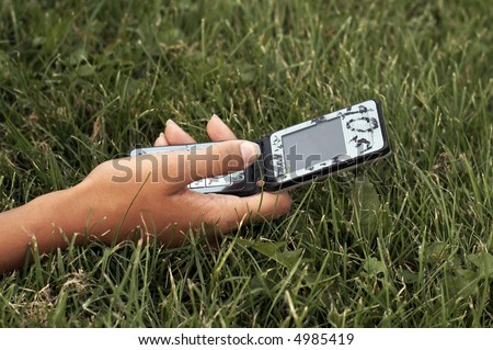 Hand holding cell phone - stock photo