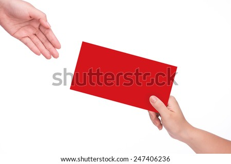 Hand holding chinese red envelope isolated over white background - stock photo