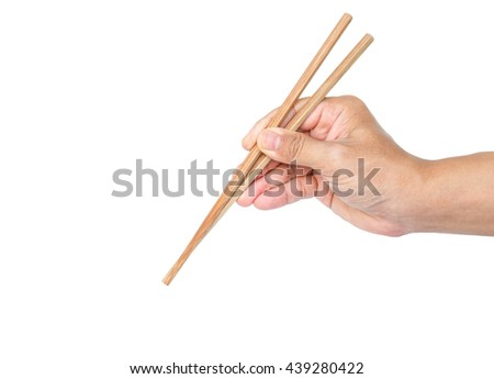 hand holding chopsticks tradition chinese japanese on white background