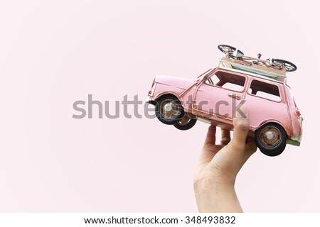Hand holding classic mini model with bicycle, Travel concept - stock photo