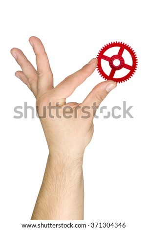 Hand holding cogwheel isolated - stock photo