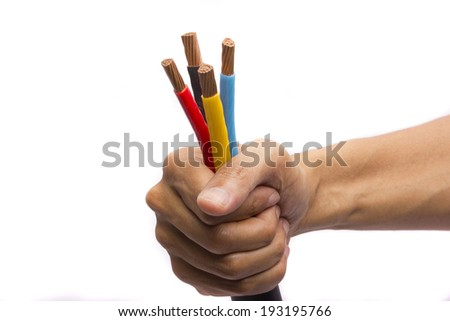 Hand holding colorful electric cables - stock photo