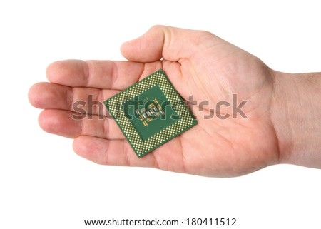 Hand holding computer cpu, cut out on white background - stock photo