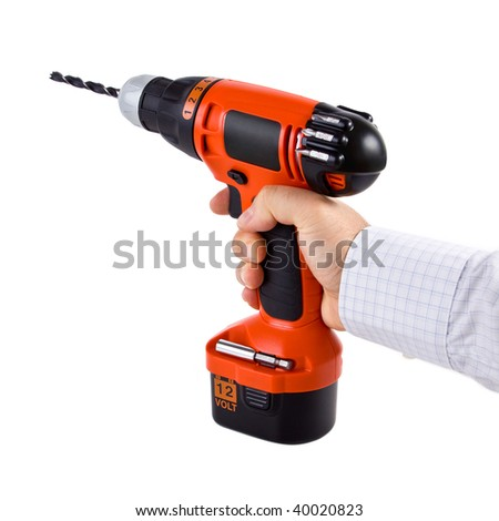 Hand holding cordless drill - stock photo