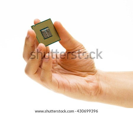 Hand holding CPU processor, on white background - stock photo