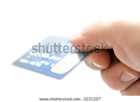 Hand holding credit cards. Small DOF - stock photo
