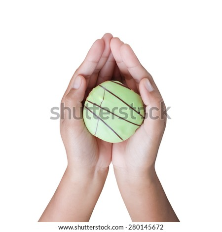 Hand holding cup cake isolate on white background - stock photo