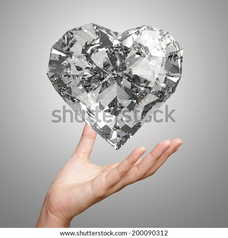 hand holding 3d diamond heart shape as concept - stock photo