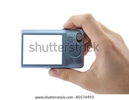 Hand holding digital camera. Clipping path included - stock photo