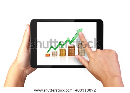 Hand holding digital tablet with Money graph on display