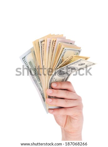 Hand holding dollar banknotes. Isolated on a white background. - stock photo