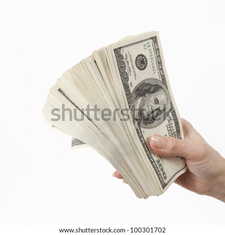 Hand holding dollar banknotes isolated on white - stock photo