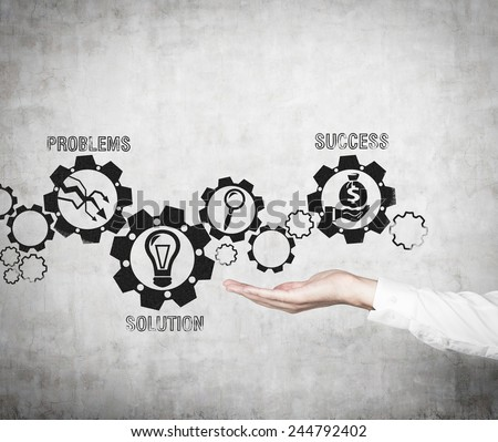 hand holding drawing gears with business icons - stock photo