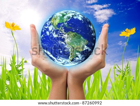 hand holding earth, saving earth concept. Earth globe image provided by NASA - stock photo