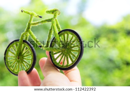 Hand Holding Eco bicycle icon concept - stock photo