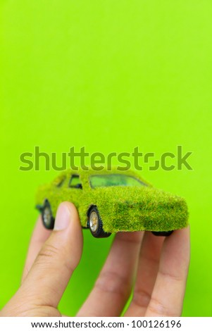Hand Holding Eco car icon isolate on green background - stock photo