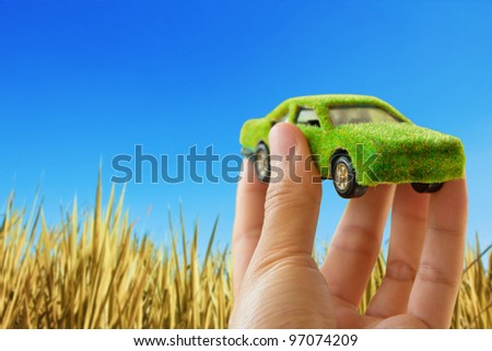 Hand Holding Eco car icon,save energy concept - stock photo