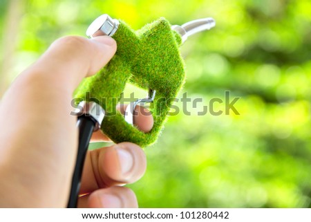 hand holding eco fuel nozzle,energy concept - stock photo