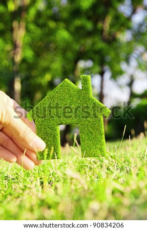 hand holding eco house icon - stock photo