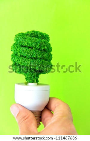 hand holding eco light bulb - stock photo