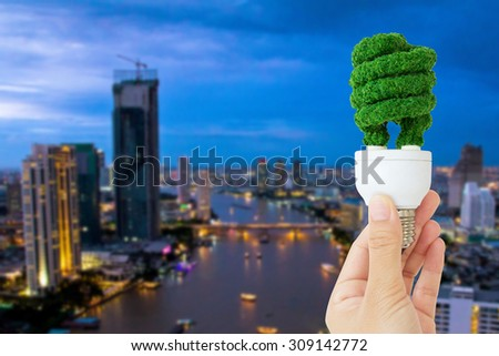 hand holding eco light bulb energy concept  - stock photo