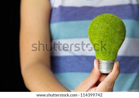 hand holding eco light bulb, save energy concept - stock photo