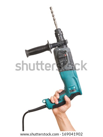 Hand holding electric drill with stone bit. Tool has some signs of usage. - stock photo
