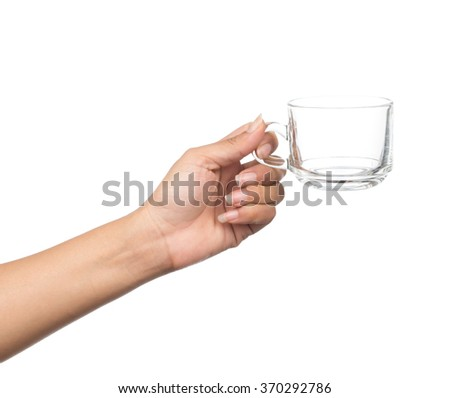 hand holding empty glass isolated on white background