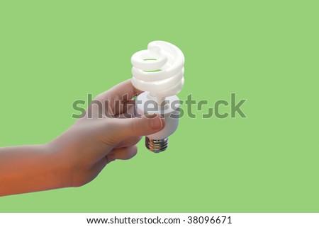 Hand holding energy saving CF light bulb off - stock photo