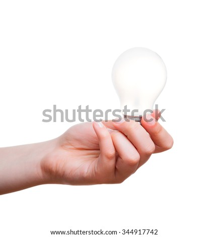 hand holding energy saving lamp on a white background