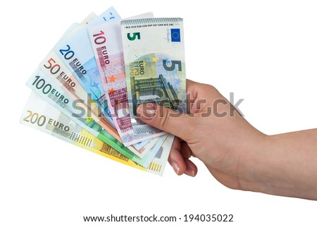 Hand holding euro banknotes isolated on white background with clipping path