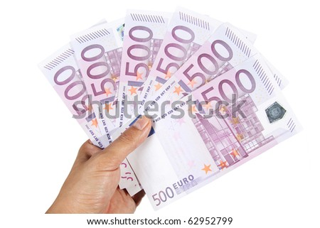 Hand holding 500 euro bills - stock photo
