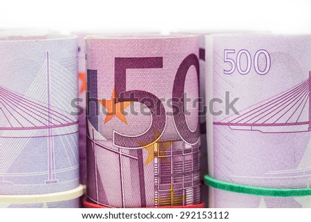 hand holding 500 euro roll on white background - stock photo
