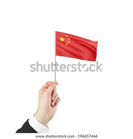 hand holding flag of China on white background - stock photo