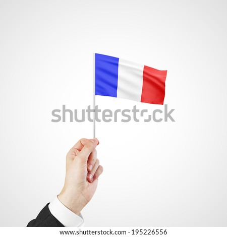 hand holding flag of France  on white background - stock photo