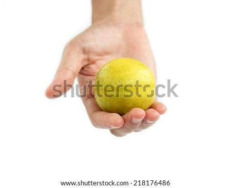 Hand holding Fresh limes isolated on white background. - stock photo