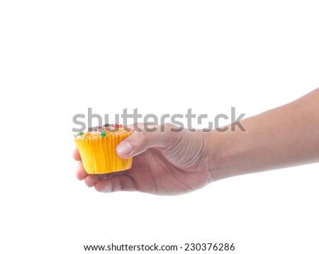hand holding fruit cupcake isolate on white background - stock photo