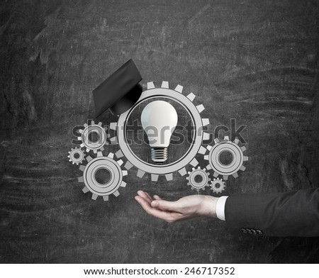 hand holding gears and bulb, education concept - stock photo