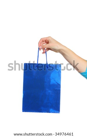 Hand holding gift bag isolated on white background - stock photo