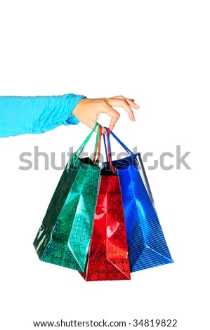 Hand holding gift bags isolated on white background