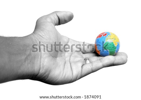 Hand holding globe of the Earth - stock photo
