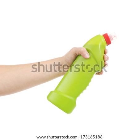 Hand holding green bottle. Isolated on a white background.