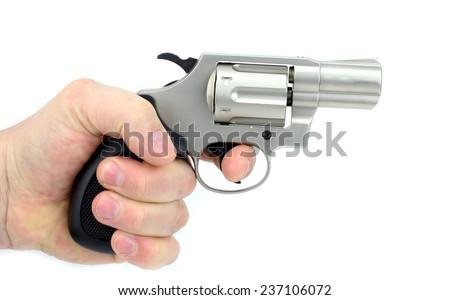 Hand holding gun on white background - stock photo