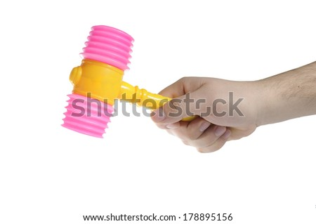 Hand holding hammer toy on isolated white background