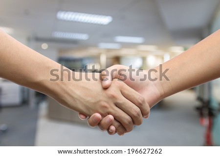Hand holding hand isolated over white background - Friendship, Shaking hands Business, Congratulation - stock photo