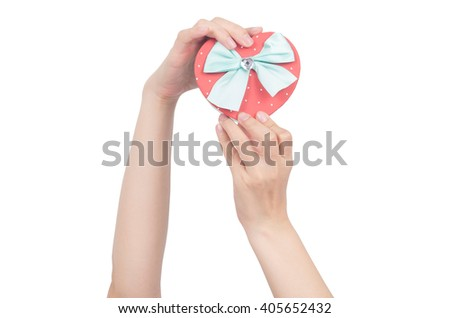 hand holding heart box,gift box isolated with clipping path