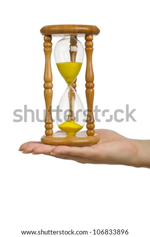 Hand holding hourglass on white - stock photo